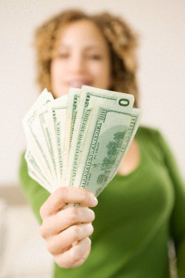 http://www.corbisimages.com/stock-photo/royalty-free/42-25993521/closeup-of-womans-handful-of-money/?tab=details&caller=search